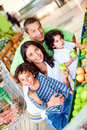 Family at the supermarket Royalty Free Stock Photos