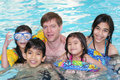 Family swimming together Royalty Free Stock Images
