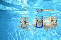 Family swims in pool under water, happy active mother and children have fun, fitness and sport with kids on vacation Royalty Free Stock Photo