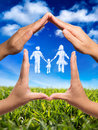 Family symbol in home hands and clouds nature Royalty Free Stock Images
