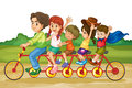 Family on tandem bike riding same in park Stock Images
