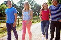 Family with teenage children walking in countryside daylight chatting Stock Images