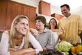 Family with teenagers making faces in kitchen Royalty Free Stock Photo