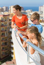 Family of three on the balcony of the room Royalty Free Stock Photo