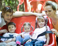 Family and three children in park. Royalty Free Stock Photo