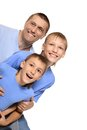 Family of a three cute fothreeur in blue clothes Stock Photo