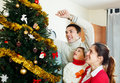 Family of three preparing for christmas laughing Stock Photography