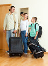 Family of three with teenager by the door with bags going for vacation Royalty Free Stock Images