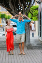 A family of three are walking. Baby girl is sitting on her fathers shoulders. Royalty Free Stock Photo