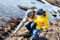 Family at tide pools of father and son enjoying together Royalty Free Stock Images