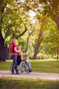 Family time- senior man in wheelchair and daughter in the park Royalty Free Stock Photo