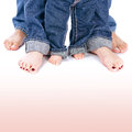 Family togetherness mother father and little child wearing blue jeans barefoot people legs isolated on white background body part Stock Photos