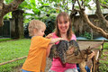 Family touching monitor lizard bali reptile park Royalty Free Stock Images