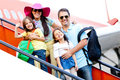 Family traveling by airplane Royalty Free Stock Photo