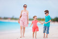 Family on tropical beach vacation Royalty Free Stock Photography