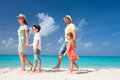 Family on a tropical beach vacation happy beautiful Stock Photos