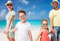 Family on a tropical beach vacation happy beautiful Stock Photo