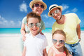 Family on a tropical beach vacation happy beautiful Stock Image