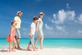 Family on a tropical beach vacation happy beautiful Stock Images