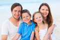 Family on a tropical beach vacation happy beautiful Royalty Free Stock Photo