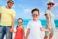 Family on a tropical beach vacation happy beautiful Royalty Free Stock Image