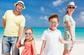 Family on a tropical beach vacation happy beautiful Royalty Free Stock Photography