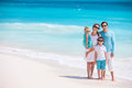 Family on a tropical beach vacation portrait of beautiful caucasian at Stock Photography
