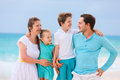 Family on a tropical beach vacation portrait of beautiful caucasian at Royalty Free Stock Photography