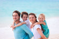 Family on a tropical beach vacation portrait of beautiful caucasian at Stock Photos