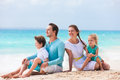Family on a tropical beach vacation portrait of beautiful caucasian at Royalty Free Stock Image