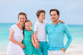 Family on a tropical beach vacation portrait of beautiful caucasian at Royalty Free Stock Photo