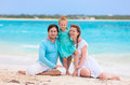 Family on a tropical beach vacation portrait of beautiful caucasian Royalty Free Stock Photo