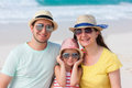 Family on a tropical beach vacation portrait of beautiful caucasian Stock Photography