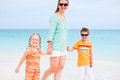 Family on tropical vacation portrait of happy enjoying beach Stock Images