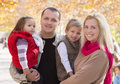 Family with two children in autumn park happy Stock Photo