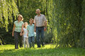 Family with two children is walking in park Stock Image