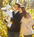 Family with two daughters in autumn forest Stock Photo