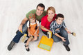 Family with two kids ready to pait their home Royalty Free Stock Photo