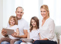 Title: Family and two kids with tablet pc computers
