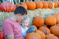 Family of two at pumpkin patch young father and his cute smiling son spending time together Royalty Free Stock Photo