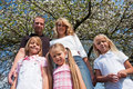 Family under apple tree in spring Stock Photography