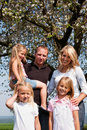 Family under apple tree in spring Royalty Free Stock Photos