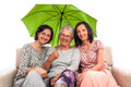 Family under green umbrella Royalty Free Stock Photos