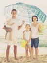 Family under sun umbrella on the beach