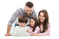Family using laptop together young with two children Royalty Free Stock Photo