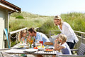 Family on vacation eating outdoors Stock Image