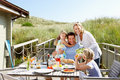 Family on vacation eating outdoors Royalty Free Stock Photo