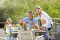 Family on vacation eating outdoors Stock Photos