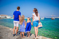 Family vacation in Europe. Parents and kids looking at old town Chora in Mykonos island, Greece Royalty Free Stock Photo