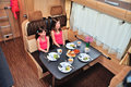 Family vacation, RV holiday trip, happy smiling kids travel on camper, motorhome interior Royalty Free Stock Photo